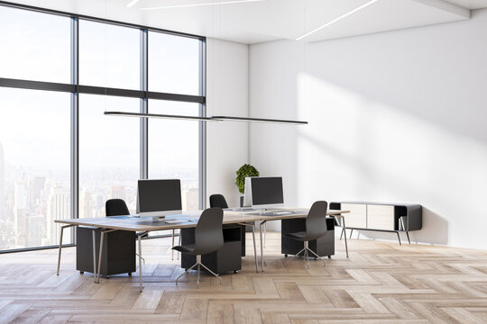Minimalistic wooden and concrete coworking office interior with equipment, furniture, different objects, city view and sunlight. 3D Rendering.