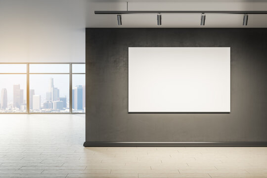 Blank wall with mock up frame in modern office interior with window and city view. 3D Rendering.