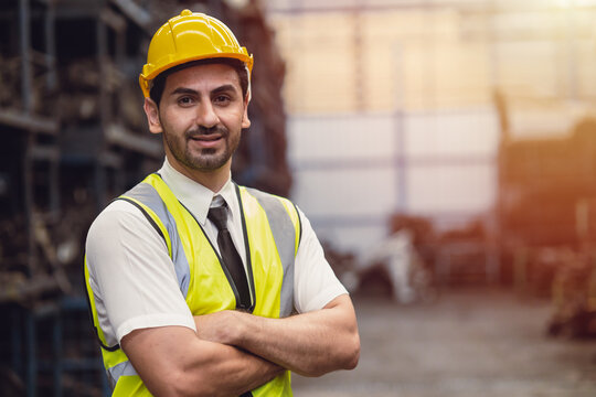 Portrait Hispanic Latin male engineer worker factory staff standing smile looking camera with space for text
