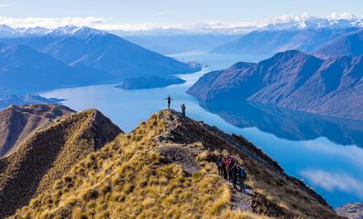 Asian tourists taking photo at Roy's Peak Lake Wanaka New Zealand