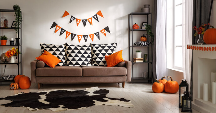 interior of house decorated for Halloween pumpkins