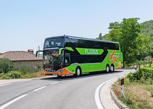 Skradin, Croatia - July 27, 2021: Tourist bus with tourists on the highway, in Skradin, Croatia.