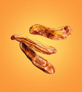 Three dried bananas close up in the air