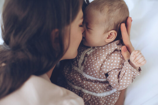 Woman with a baby. Beautiful mother with a baby. High quality photo