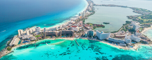 Fototapeta Aerial panoramic view of Cancun beach and city hotel zone in Mexico. Caribbean coast landscape of Mexican resort with beach Playa Caracol and Kukulcan road. Riviera Maya in Quintana roo region on obraz