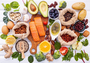 Fototapeta Ingredients for the healthy foods selection on white background. Balanced healthy ingredients of unsaturated fats and fiber for the heart and blood vessels. obraz