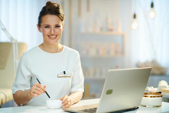 happy 40 years old woman employee in beauty studio working