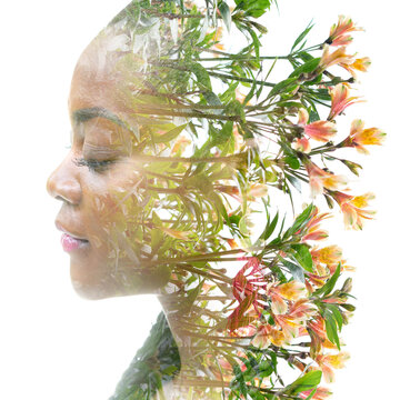 Double exposure portrait of a young woman combined with flowers.