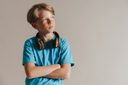 Portrait of a casual preteen boy in t-shirt standing