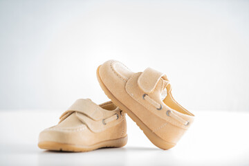 kid shoes in white background for online shop