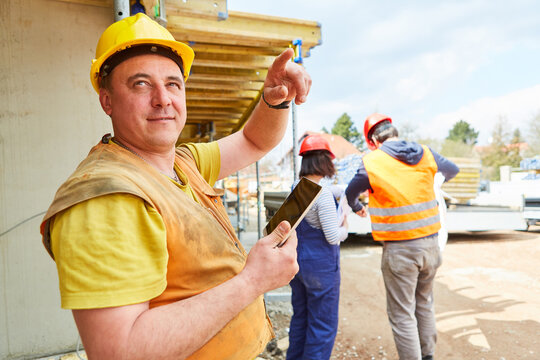 Foreman on construction site of house construction during planning