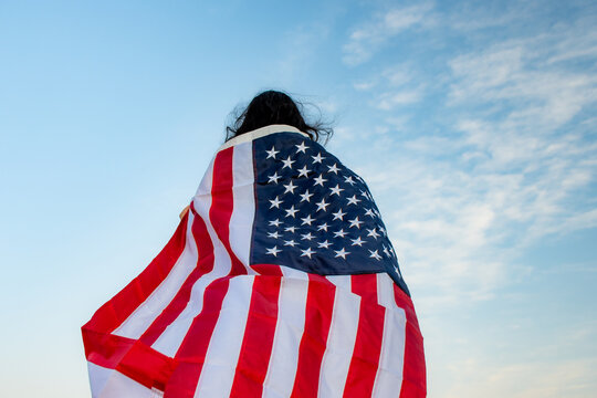 Rear view of woman with american flag
