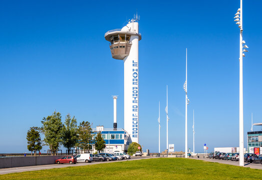 """Le Havre, France - June 13, 2021: Control tower and harbor master's office of the port of Le Havre. The text on the tower reads """"Le Havre Gateway of Europe""""."""