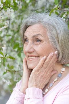 happy smiling senior woman outdoors