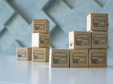 Business Growth and franchise concept. Cubes with shops.