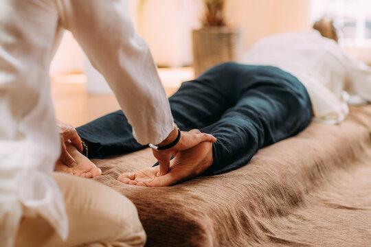 Shiatsu Foot Massage. Therapist Massaging the Kidney Meridian