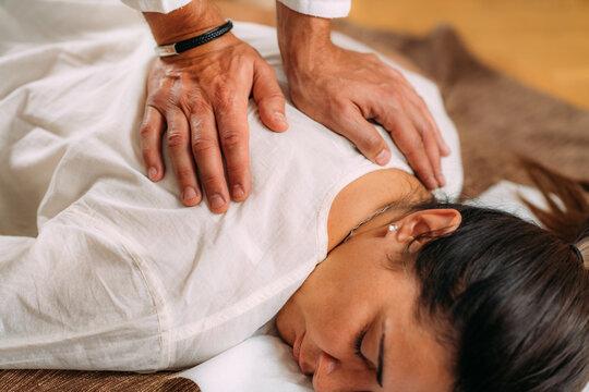 Woman Getting Shiatsu Back Massage.