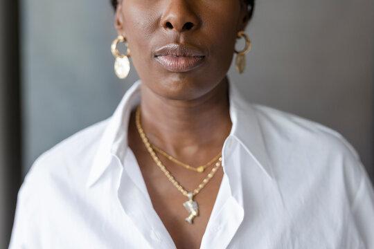 Close up portrait businesswoman wearing gold jewelry