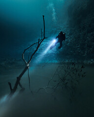diving in Cenote Angelita with foggy halocline in mexico