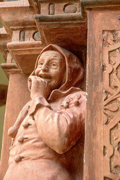 terracotta figure of a fool on the balustrade in the inner yard of the renaissance building of Schallaburg castle, Austria