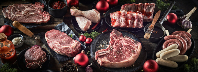 Fototapeta Assorted fresh meat on table with Christmas baubles obraz