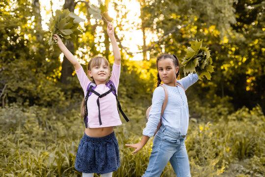 schoolgirls among the autumn landscape.