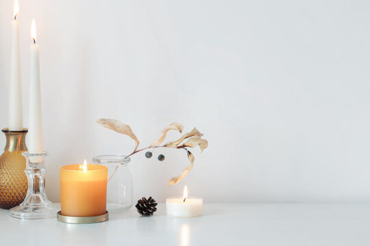 autumn home decorations with burning candles