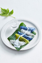 Fototapeta Colorful Thai dumplings Khao Kriab Pak Moh on plate obraz