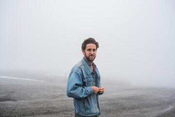 Fototapeta USA, Alaska, Portrait of man in foggy landscape in Kenai Fjords National Park obraz