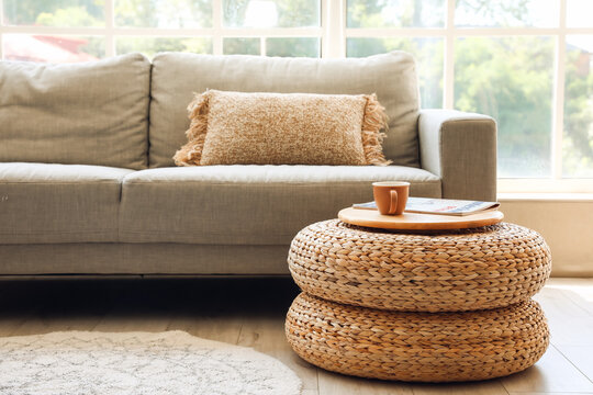 Rattan poufs with cup of coffee and magazine in living room