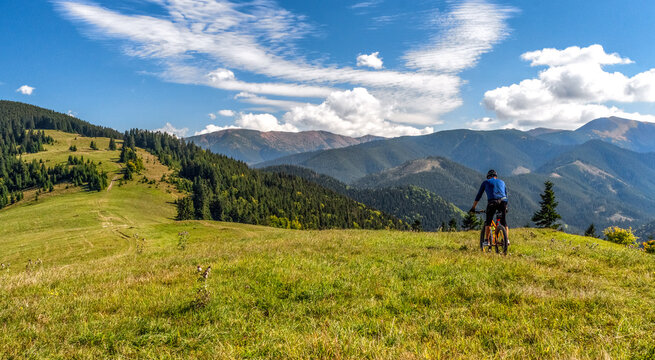 Biker on MTB bike at  mountains trail in Low Tatras mountains, Slovakia