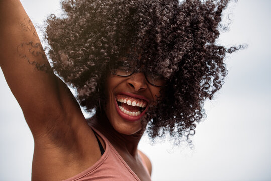 Happy ethnic female with curly hair