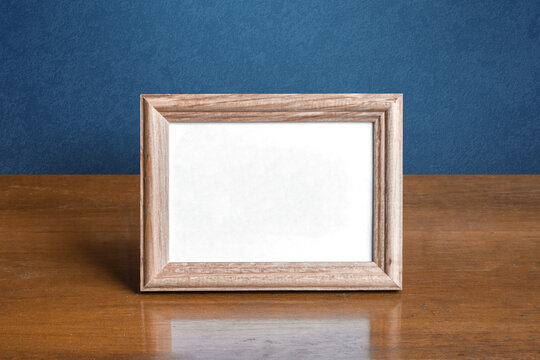 frame on table, blue wall