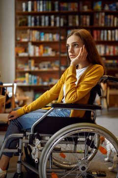 Thoughtful disabled female student in wheelchair
