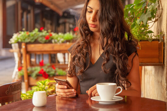 Young beautiful woman with smartphone as symbol of social Media addiction. Psychological problems and media mania concept.
