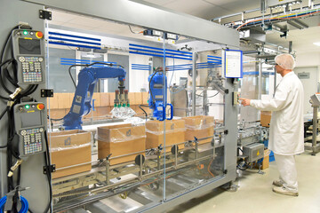 Fototapeta medical products manufacturing in a modern factory - worker operates modern industrial plant obraz