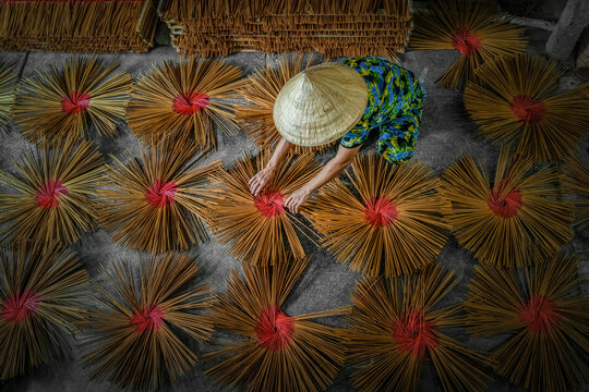 Top view of vietnamese working with red incense in house at long xuyen, an giang province, vietnam,traditional and culture concept