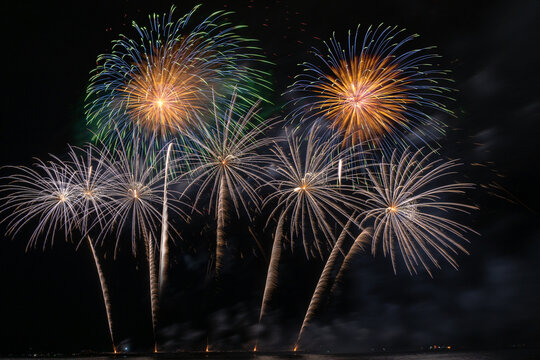 Fantastic Multicolor Firework exploding for Celebration from the big boat over the sea, celebration and happy new year and merry christmas concept