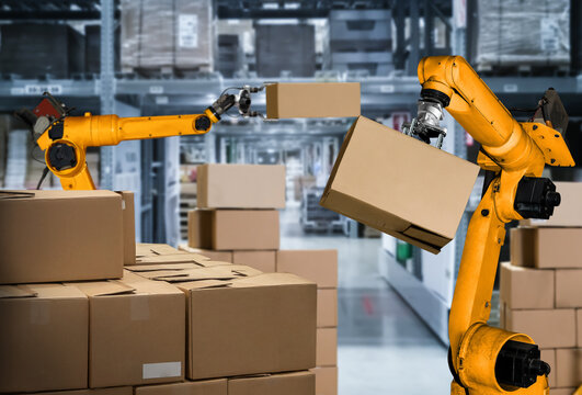 Smart robot arm system for innovative warehouse and factory digital technology . Automation manufacturing robot controlled by industry engineering using IOT software connected to internet network .