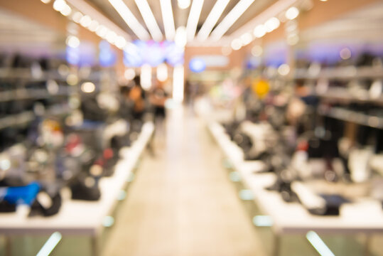 Interior of outlet shop in shoes section as blurred store background