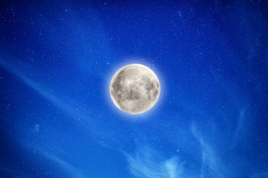 Big full moon on night sky with stars