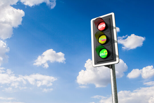 Ampelkoalition (traffic light coalition) concept. The German parties SPD, FDP and Die Gruenen can build a traffic light coalition derived from their colors. Traffic and sky with logos of the parties.