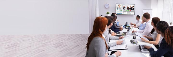 Fototapeta Businesspeople Having Video Conference In Boardroom obraz