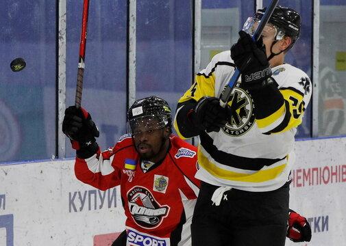 HC Donbass player Jalen Smereck in action against Gleb Maltsev of HC Kramatorsk during Ukrainian Hockey Championship match in Kramatorsk
