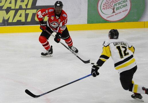 HC Donbass player Jalen Smereck in action against Sergei Gritsenko of HC Kramatorsk during Ukrainian Hockey Championship match against HC Kramatorsk in Kramatorsk