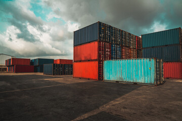 Fototapeta Cargo container for overseas shipping in shipyard with heavy machine . Logistics supply chain management and international goods export concept . obraz