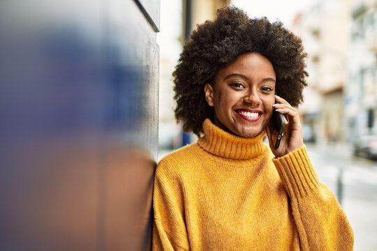 Young african american girl smiling happy talking on the smartphone at the city.