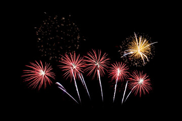 Many flashing colorful fireworks in event amazing with black background celebrate New Year, holiday and festival in night.