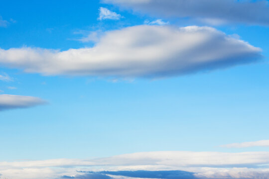 fluffy clouds on a blue sky. beautiful nature background in spring