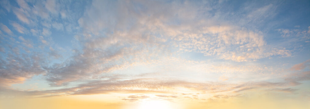 Sunlight, clouds and pastel blue sky background, panoramic angle view sky white cloud and bright sun for background